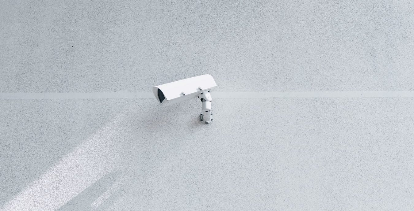 Security Camera On A White Wall Background